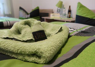 Handtücher und Willkommensschokolade